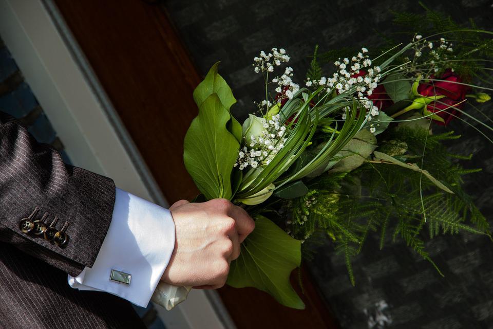 man holding flowers